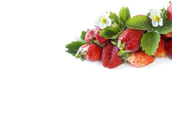 Various fresh summer fruits. Ripe strawberries on white background. Strawberries at border of image with copy space for text.