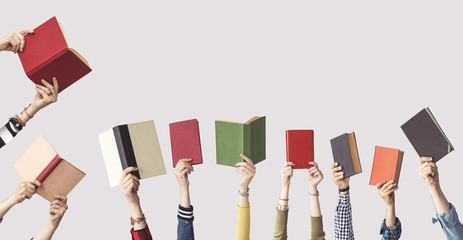 The hands of people hold books