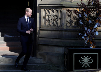 Britain's Prince William leaves a tribute message as he leaves a memorial service on the first anniversary of the Manchester Arena bombing, in Manchester