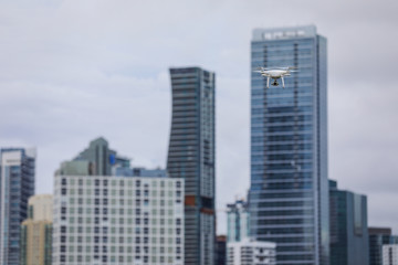 Image of a drone with a skyscraper in the background