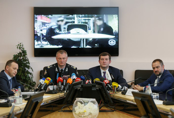 President of Ukrainian Football Federation Pavelko and head of National Police Kniaziev attend a news conference at the police headquarters in Kiev