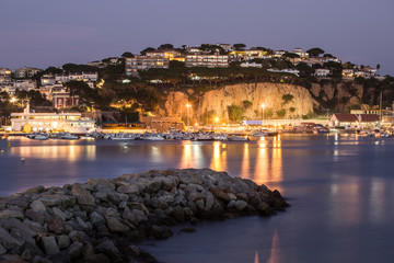 Wall Mural - Night landscape of Sant Feliu de Guixols bay in Costa Brava, Spain.