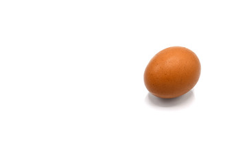 egg and a shadow on white background