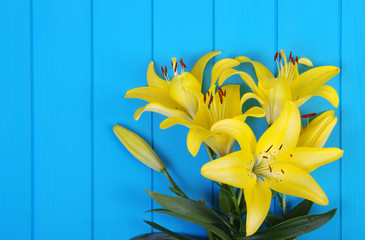 lily flowers on wooden planks