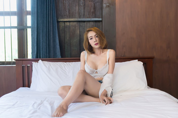 Portrait of beautiful asian sexy woman in the bedroom,Thailand people,Pose for take a picture,