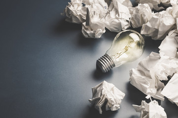 Bulb Among Crumpled Paper Wall mural