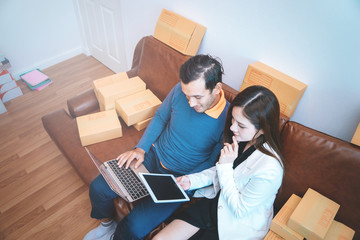 Business couple is checking stock in her online home business