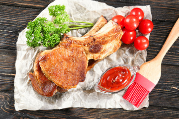 Wall Mural - Composition with delicious grilled ribs on wooden table