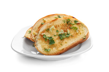 Plate with delicious homemade garlic bread isolated on white