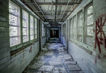 Decaying hallway in abandoned hospital in Pennslyvania