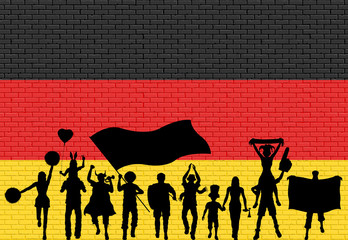 German supporter silhouette in front of brick wall with Germany flag