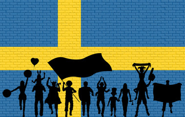 Swede supporter silhouette in front of brick wall with Sweden flag