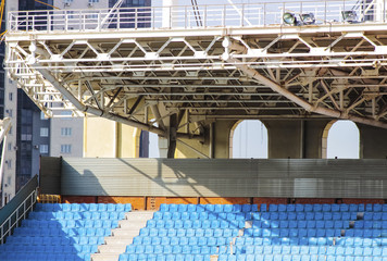 The structure of the stadium, empty rows of blue seats