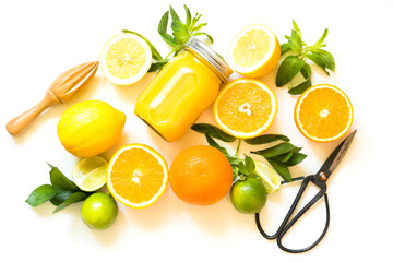 Set of citruses on white background, flat lay. Top view on oranges, lemons, lime and mint. Making detox freshes concept and recipe mockup. Top view. Tropical background.