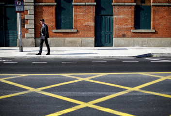 A man stands in the city centre of Dublin