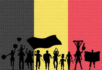 Belgian supporter silhouette in front of brick wall with Belgium flag
