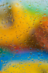 Liquid texture abstraction. Particles of oil and water with a strongly colored blurred background. The color of the holiday