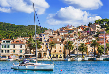 Photo on textile frame City on the water View of the Hvar town, Hvar island, Dalmatia, Croatia. Famous landmark and touristic destination for travel in Europe