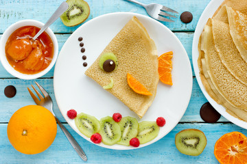 Fish pancakes with fruits and berries