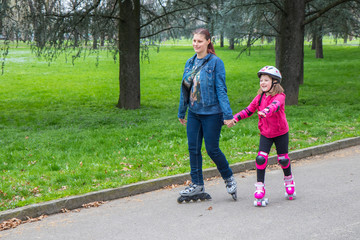 mother and daughter into the park with roller skate