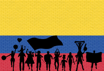 Colombian supporter silhouette in front of brick wall with Colombia flag
