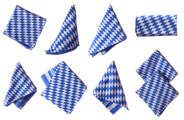 Bavarian white and blue napkin set. Oktoberfest items isolated.