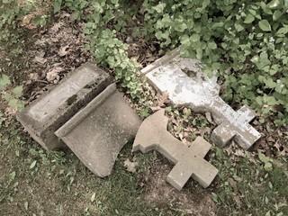 two broken crosses in an old graveyard