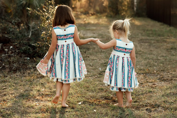 Sister walking and holding hands
