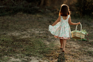 Girl with Easter Basket and Flowers
