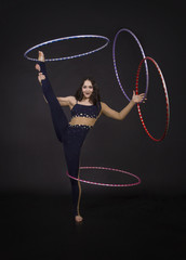 Gymnastic exercises with hula Hoop girl performs a circus artist.