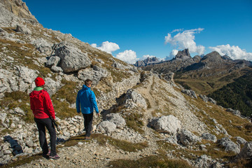 young couple in italien dolomites, rifugio lagazuoi, cortina d´ampezzo, south tyrol
