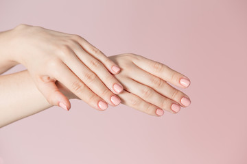 Woman's fingers with pink manicure