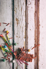 Summer: Sparkler And Firecrackers On Wooden Background