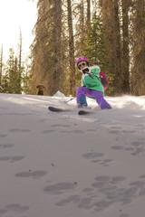 Girl skiing with dog, Colorado, USA