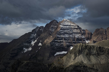 Maroon Bells mountain peaks under dramatic sky, Aspen, Colorado, USA