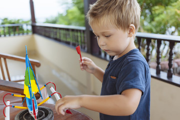 Boy playing with ship toy