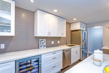 White small kitchen in modern apartment.