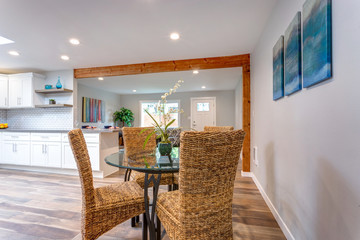 Light spacious dining area with wicker chairs.