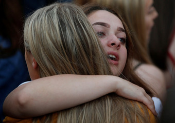 Girls hug during a choir concert on the first anniversary of the Manchester Arena bombing, in Manchester