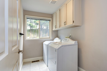 Laundry room with tiled floor.