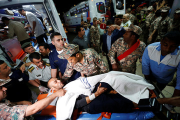 An injured Palestinian man from Gaza arrives to receive treatment at the Al Hussein Medical Centre in Amman, Jordan