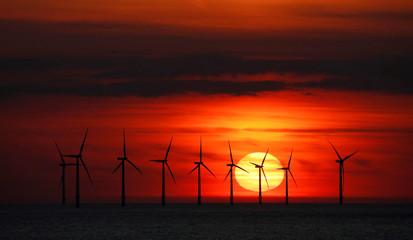 The sun sets behind the Burbo Bank wind farm near New Brighton.