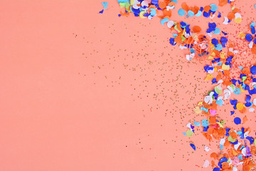 Top view of colorful party confetti background