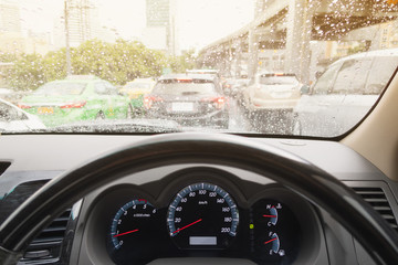 behind steering wheel with trafic jam and raining situation