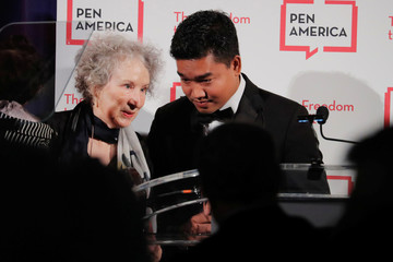 Author Margaret Atwood presents an award to Thura Aung (R) on behalf of detained Reuters journalists Kyaw Soe Oo and Wa Lone at the PEN America Literary Gala in New York