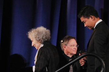 Author Margaret Atwood walks off stage after presenting an award to Thura Aung (R) on behalf of detained Reuters journalists Kyaw Soe Oo and Wa Lone at the PEN America Literary Gala in New York