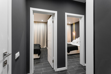 the corridor between the rooms. inexpensive family room. Hotel standart two bedroom. simple and stylish interior. interior lighting