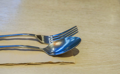 close up stainless spoon and fork set for table dinner