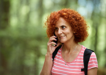 Redhead woman speaking on cellphone