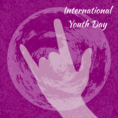 International Youth Day. 12 August. Sign of the horns. Planet Earth. Crimson grunge background